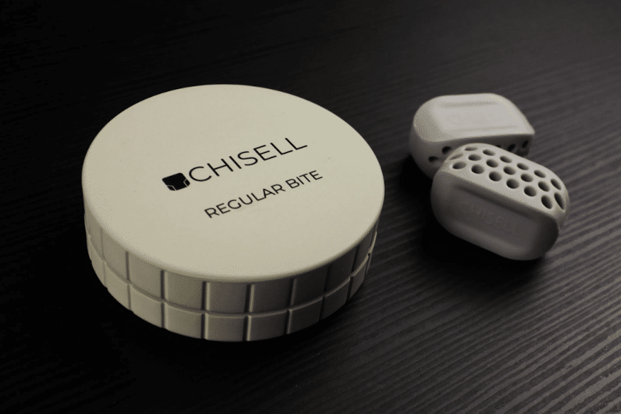 Image of the Chisell jawline exerciser mouthpieces and packaging
